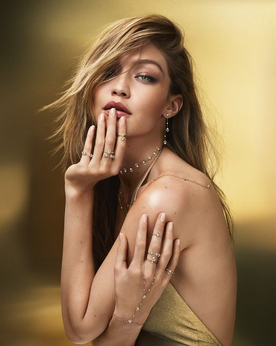Gigi Hadid wearing diamond drop earrings, layered necklaces, rings, and diamond bracelet from My Soul Collection