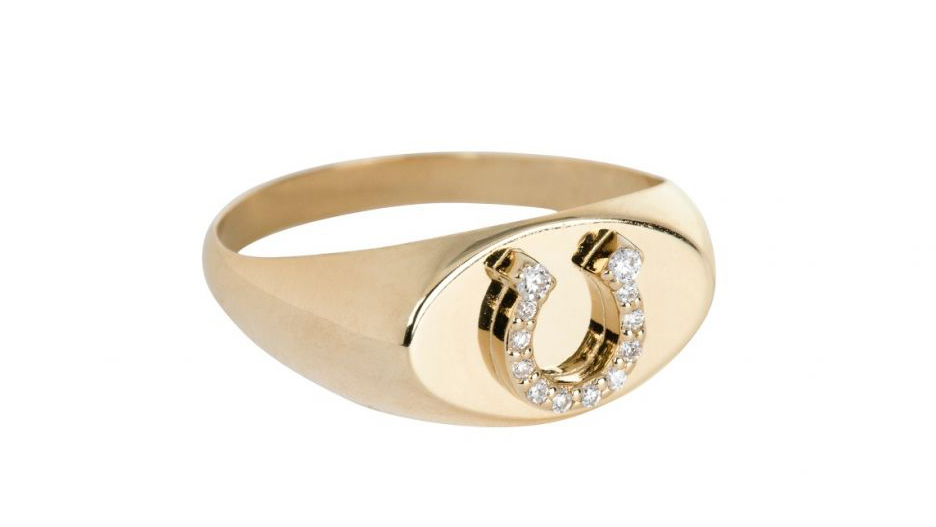 Round cut diamonds set in a horseshoe pendant signet ring with a gold band from Foundrae