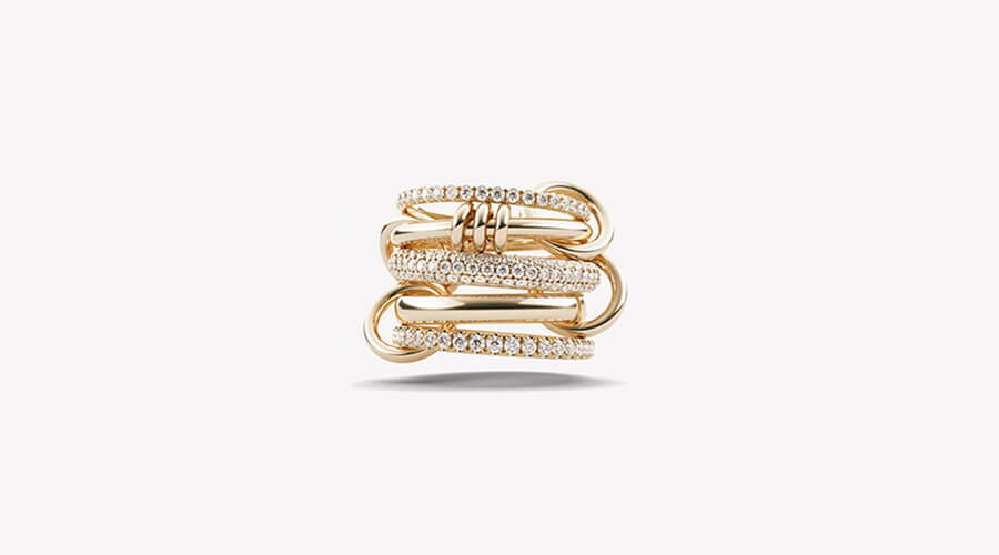 Interlocking ring with 2 gold and 3 pave diamond bands from Spinelli Kilcolli