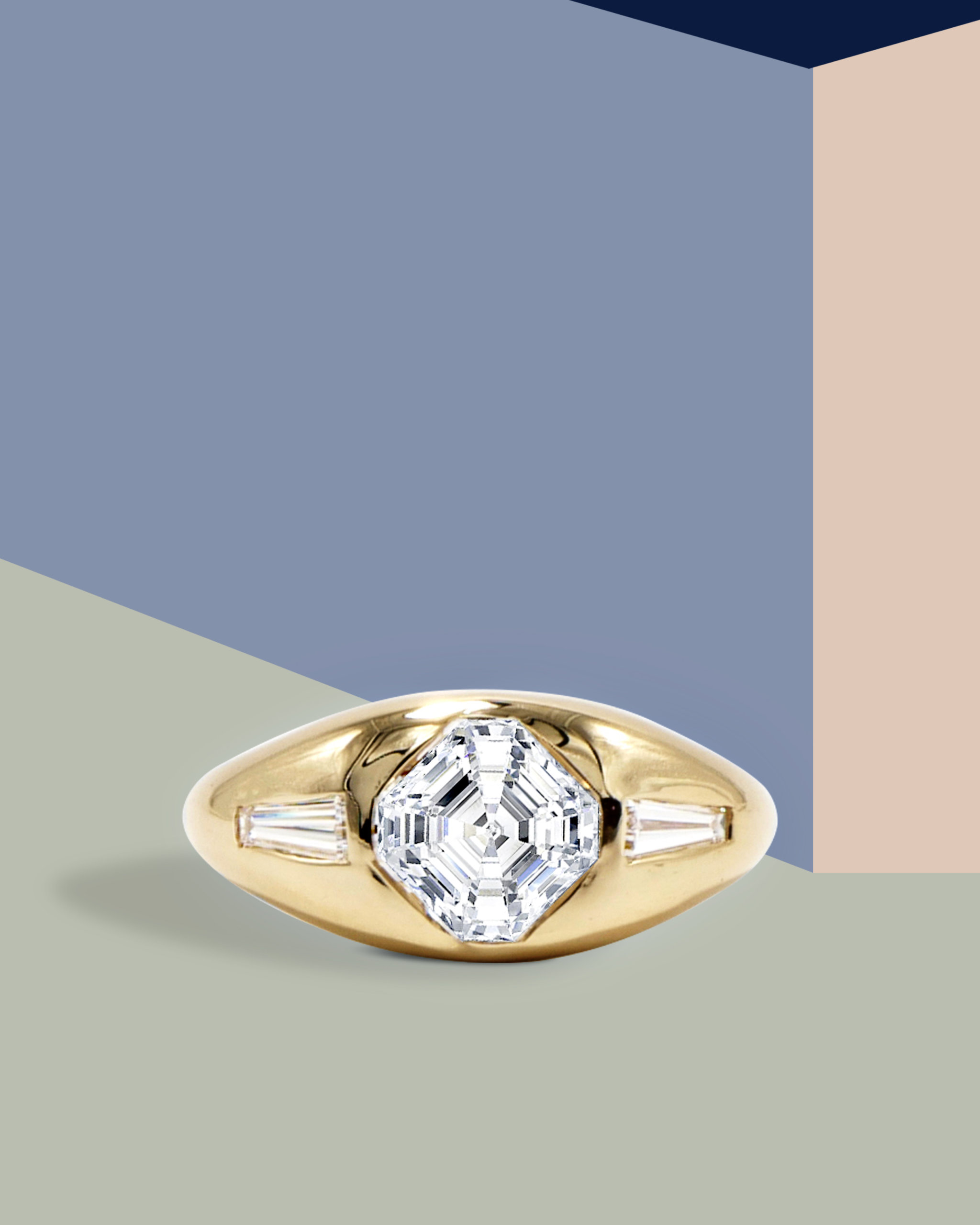 Dome-shaped gypsy engagement ring in yellow gold with a center Asscher cut diamond and two side baguette diamonds