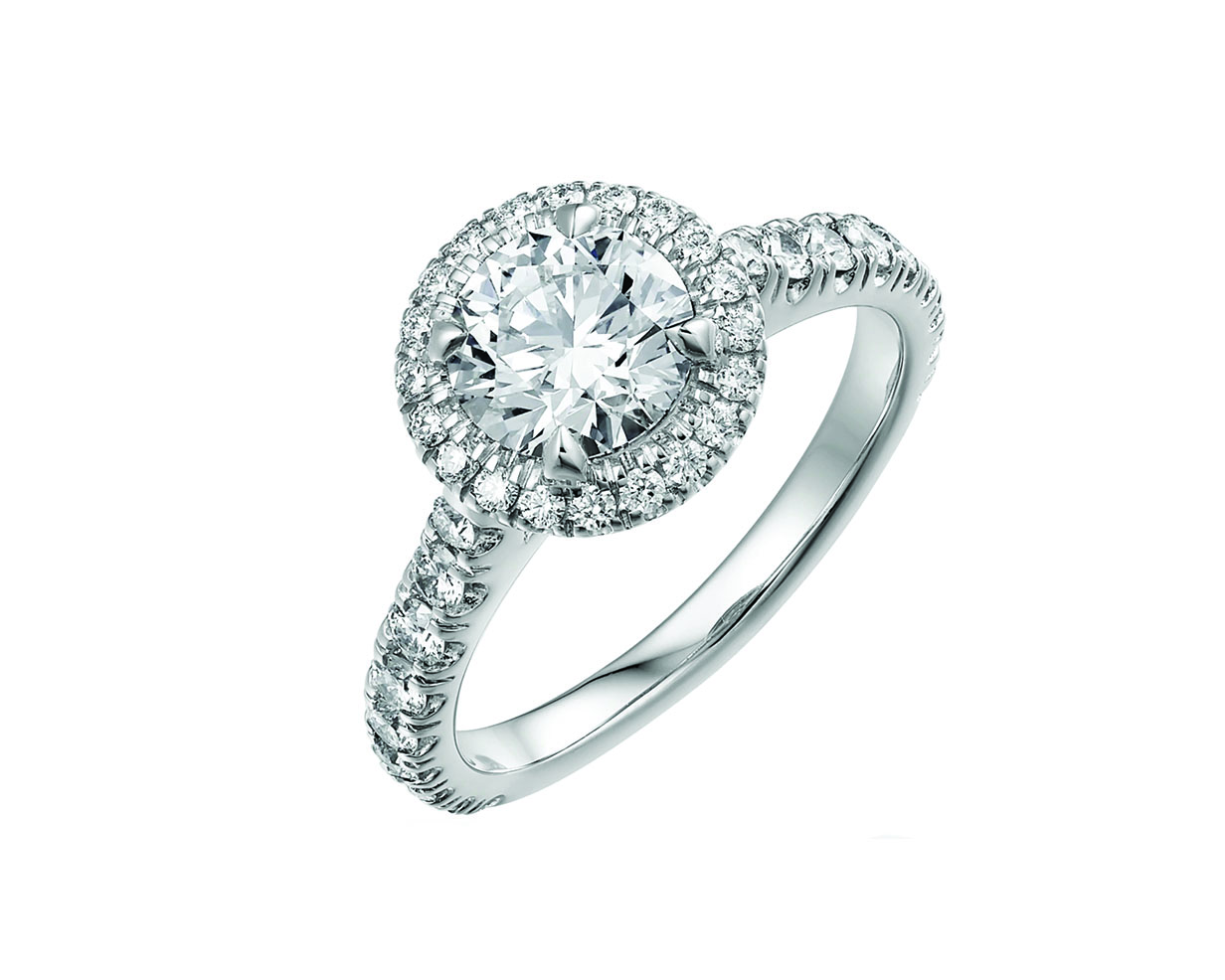 Classic round cut diamond engagement ring with a halo of diamonds and platinum diamond band