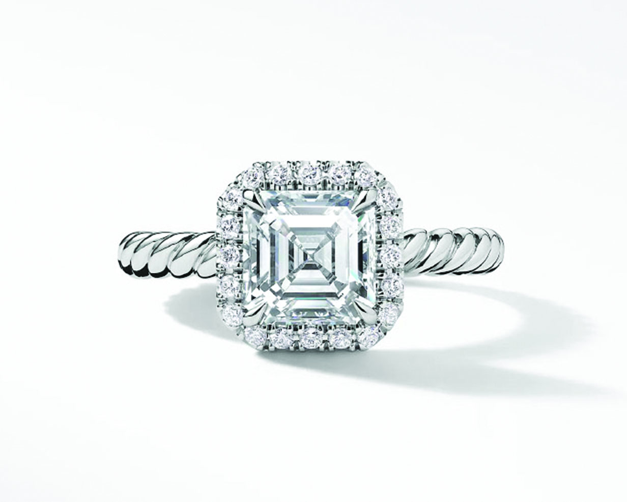 Asscher cut diamond engagement ring with paved halo and twisted platinum band