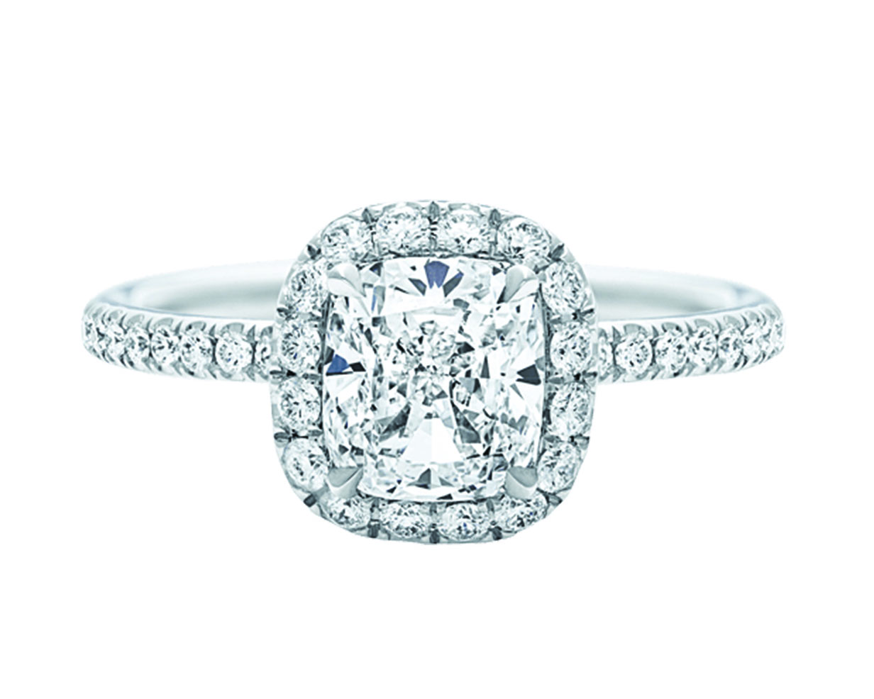 Cushion cut diamond center stone ring with paved halo and platinum pave band