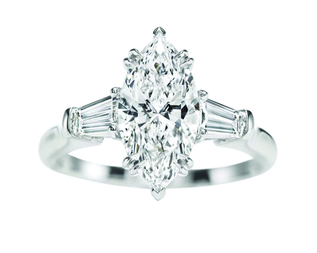 Marquise cut diamond ring with two side stones on a platinum band
