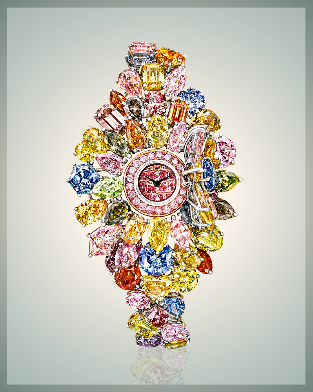 Graff Diamonds Hallucination watch featuring 110 carats worth of colored diamonds including a pink diamond face, and several different shades of blue diamonds, yellow diamonds, orange diamonds