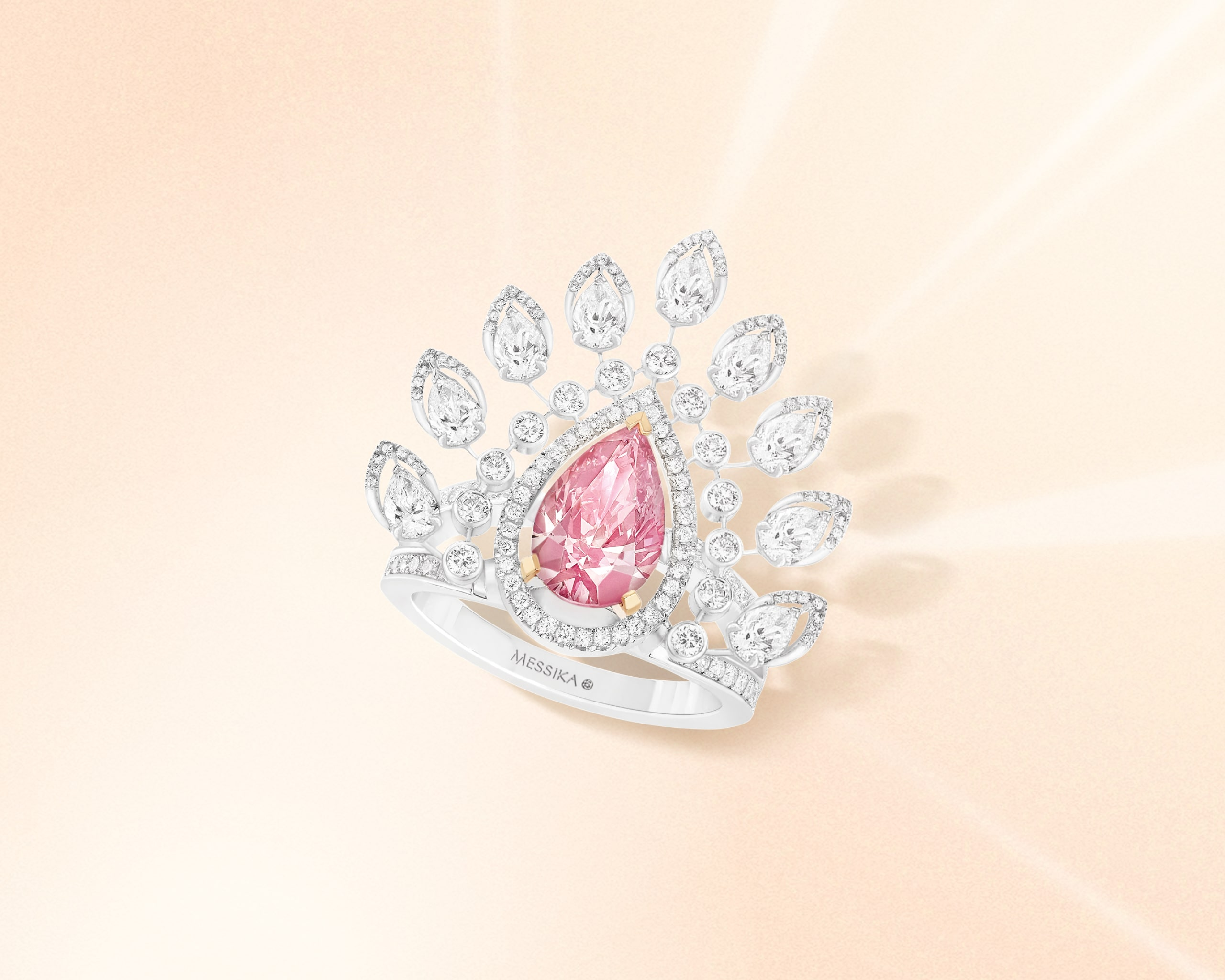 Crown shaped marquise diamond ring with pink diamond centerpiece from Desert Bloom collection by Messika