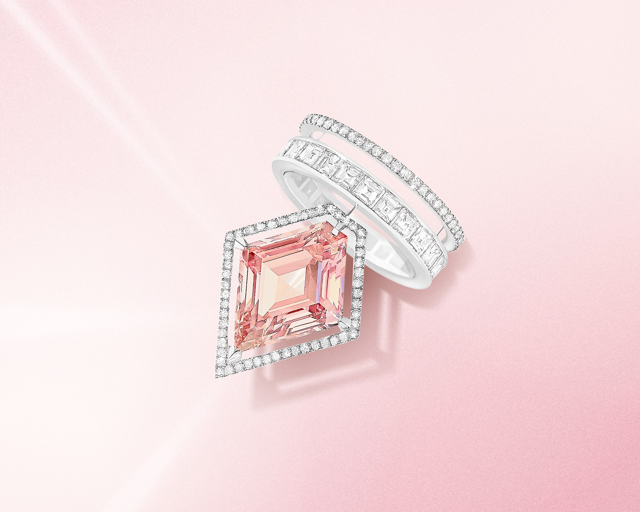 Kite cut pink diamond ring with the halo and 2 row pave diamond band
