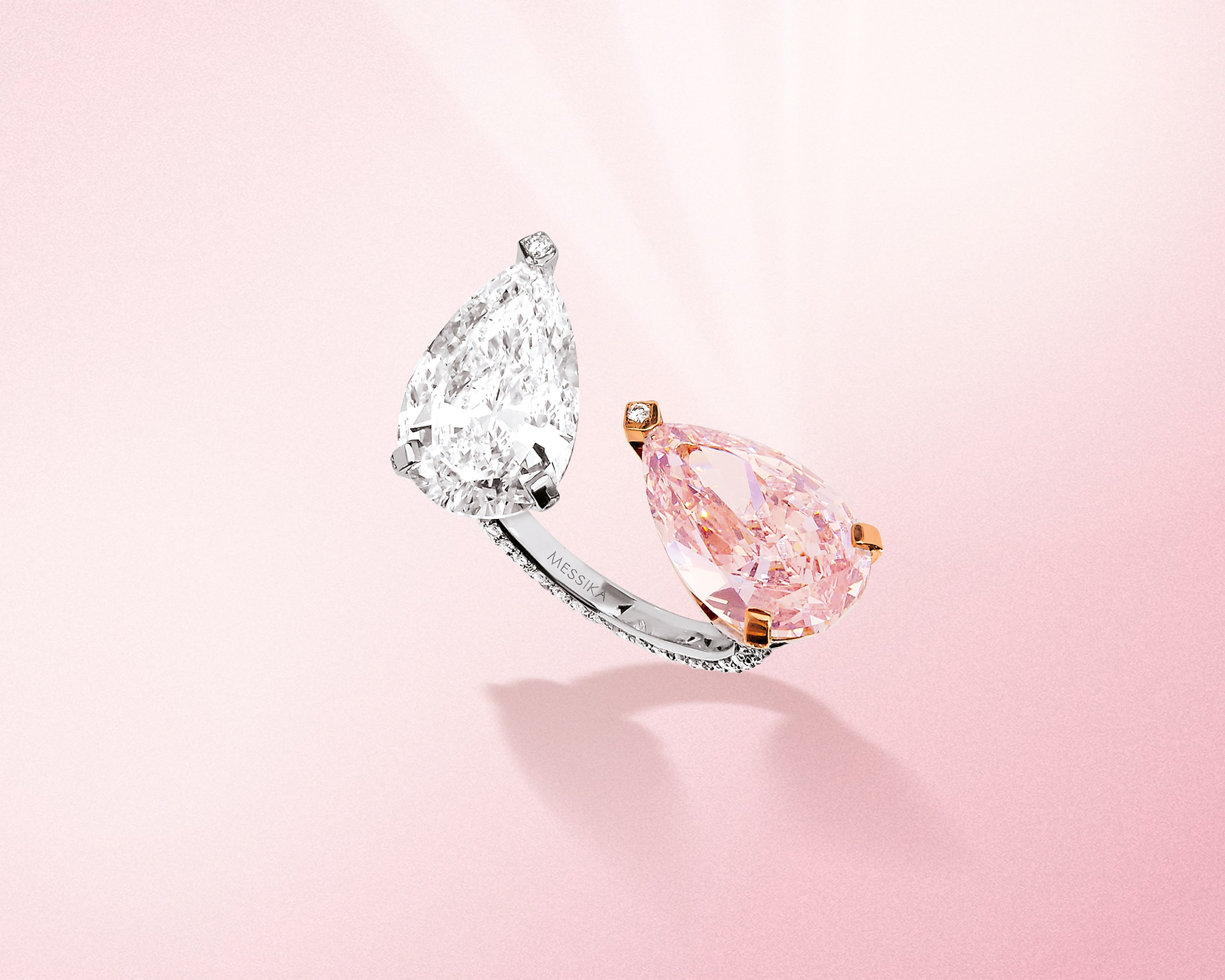 Pear shaped white and pink diamond ring in a toi et moi setting on a platinum band from Messika