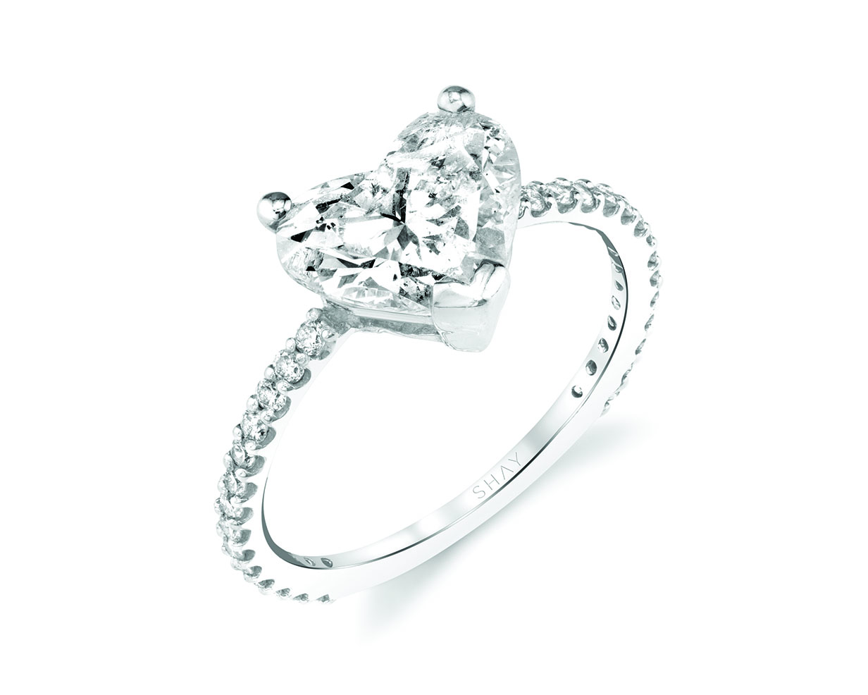 Heart cut diamond center stone engagement ring with platinum pave band