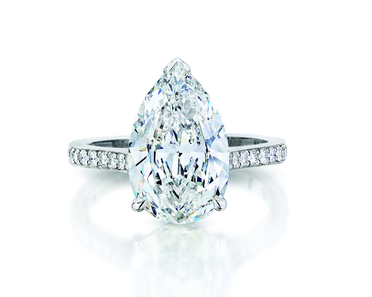 Pear cut diamond engagement ring with platinum pave band