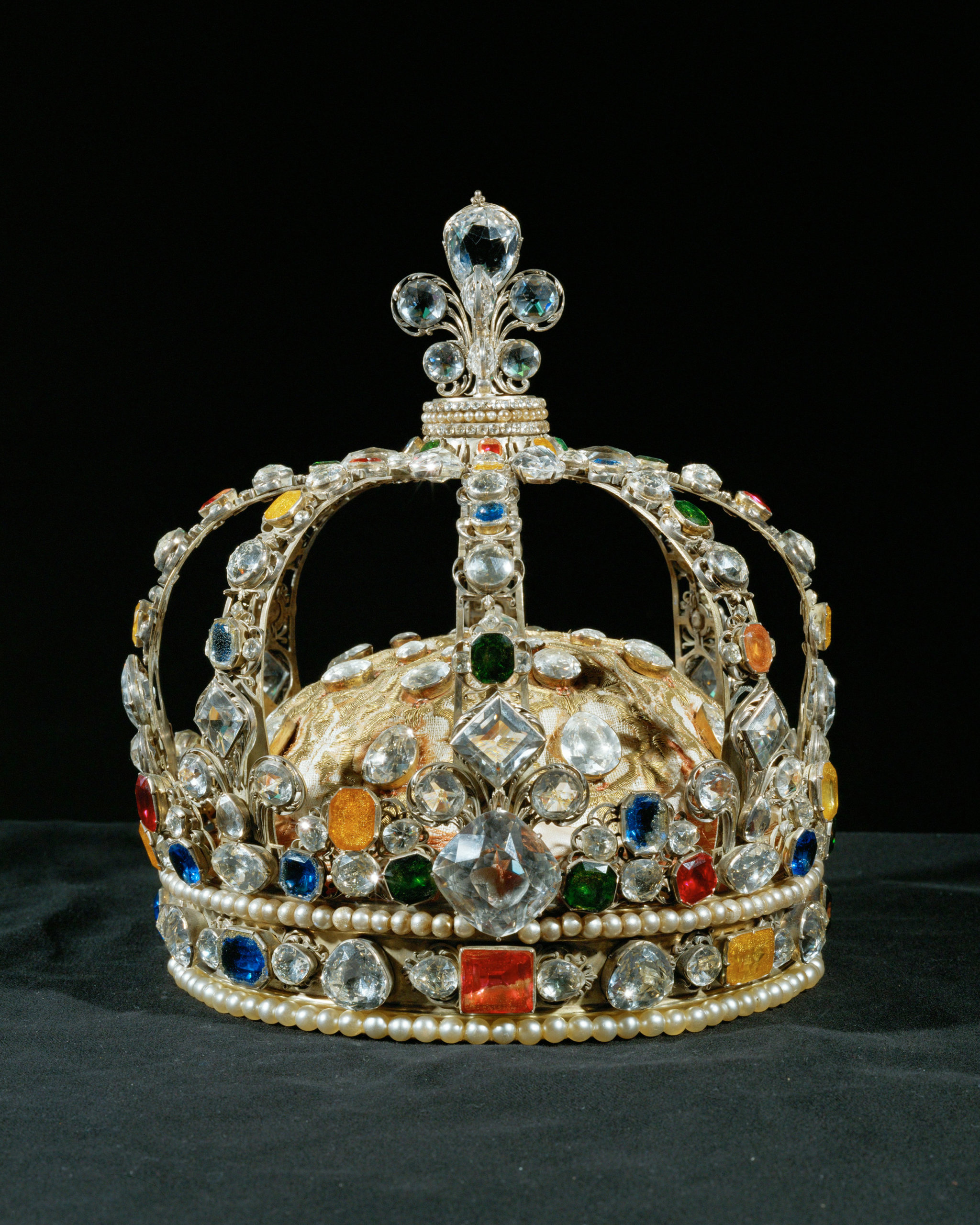 The Crown of Louis XV, embellished with Le Grand Mazarin diamond, sapphires, topazes, emeralds, rubies, and 2 rows of pearls