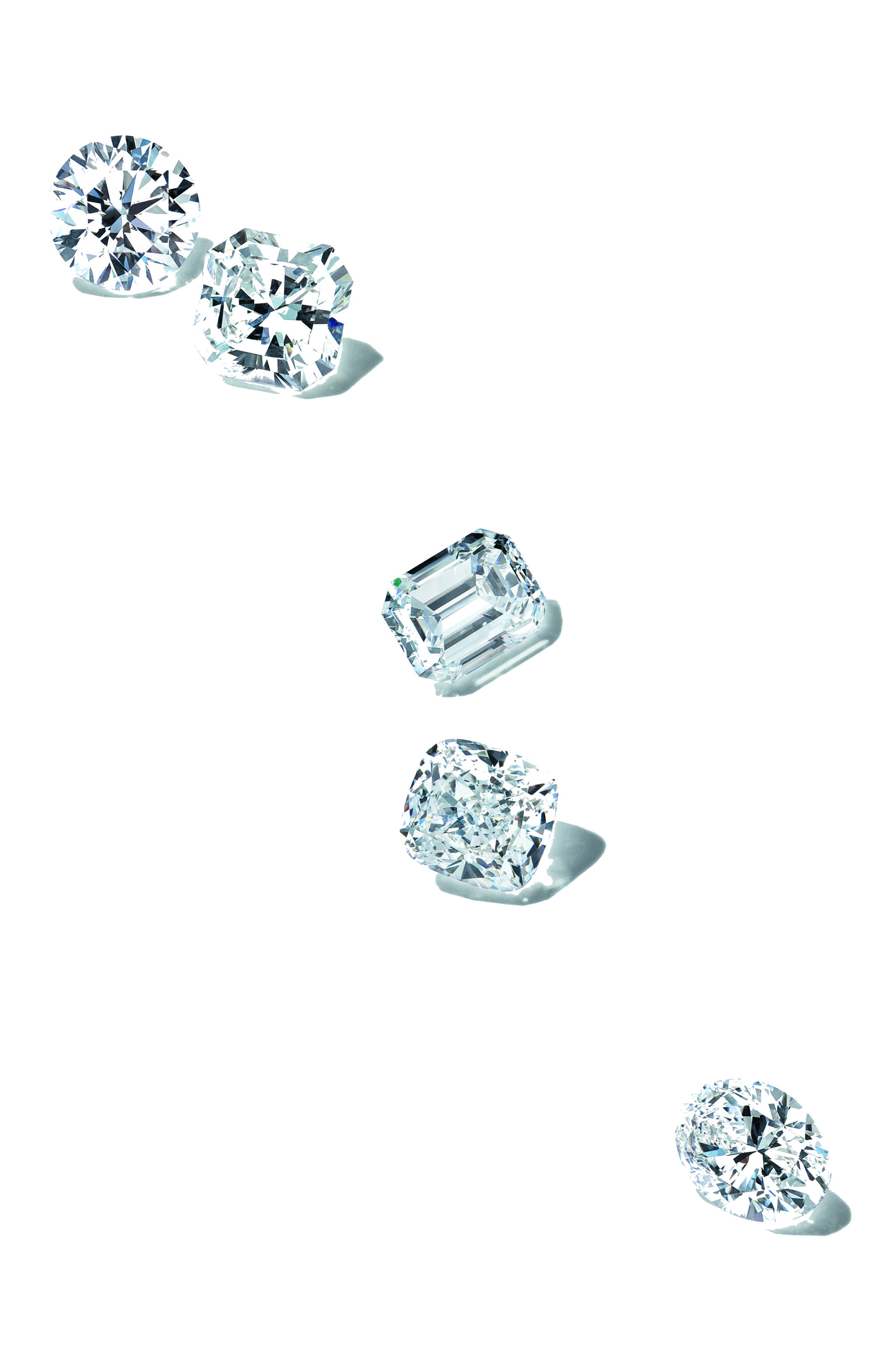 Tiffany loose diamonds after they were sorted, polished and cut. Features a round cut diamond, cushion cut diamond, emerald cut diamond, radiant cut diamond and oval diamond