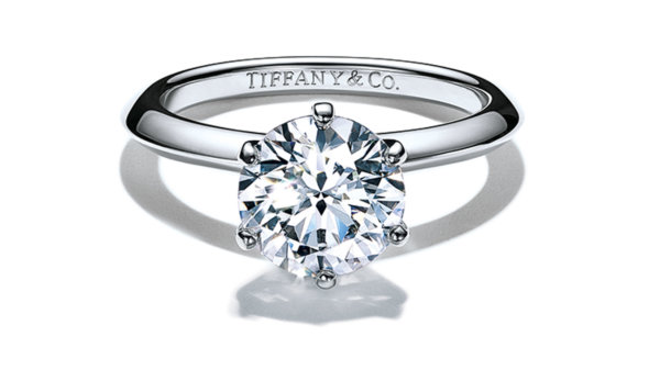 The Tiffany setting engagement ring on a platinum band featuring an ethically sourced round cut diamond engraved with Tiffany & Co. inside