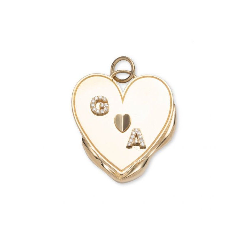 Diamond heart shaped pendant necklace engraved with personalized initials set within 18k gold