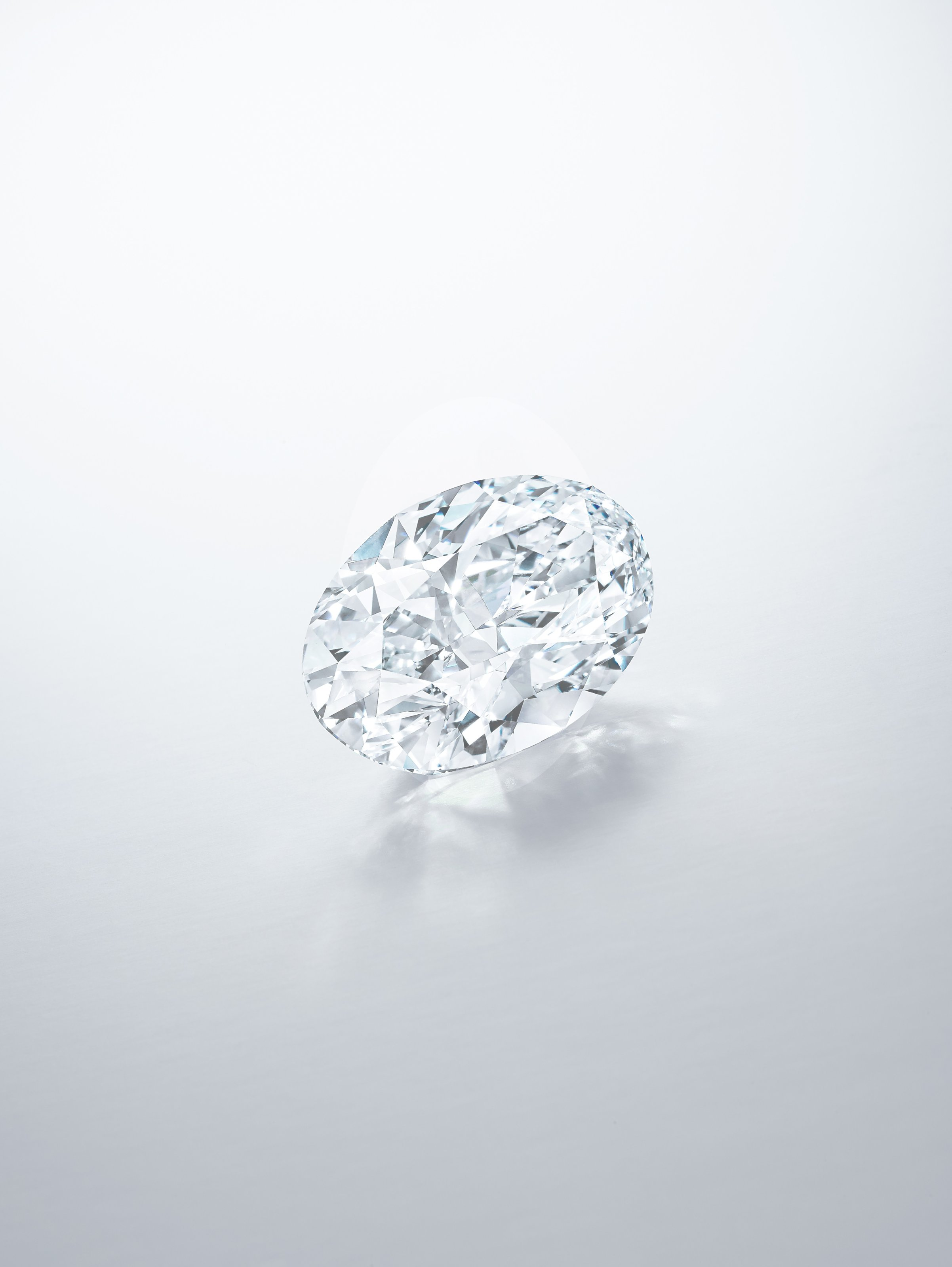 Oval cut 102 carat diamond from the Sotheby's jewelry auction showcasing brilliant diamond facets