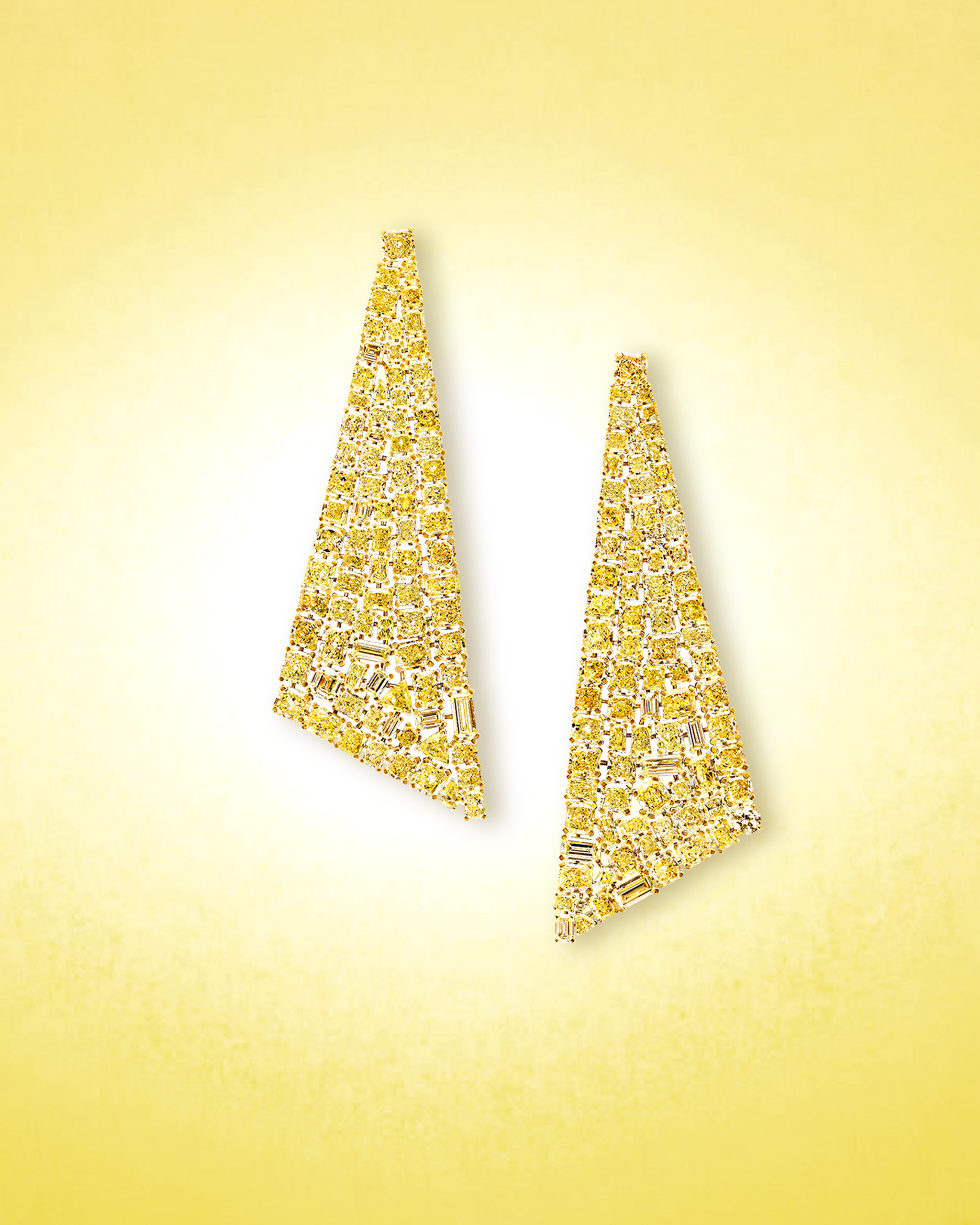 Assorted yellow diamond cuts and baguette diamonds set within statement earrings
