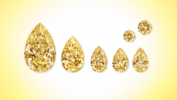 The Golden Empress' Satellite Stones: assortment of yellow, brilliant round cut & pear shaped diamonds from Graff