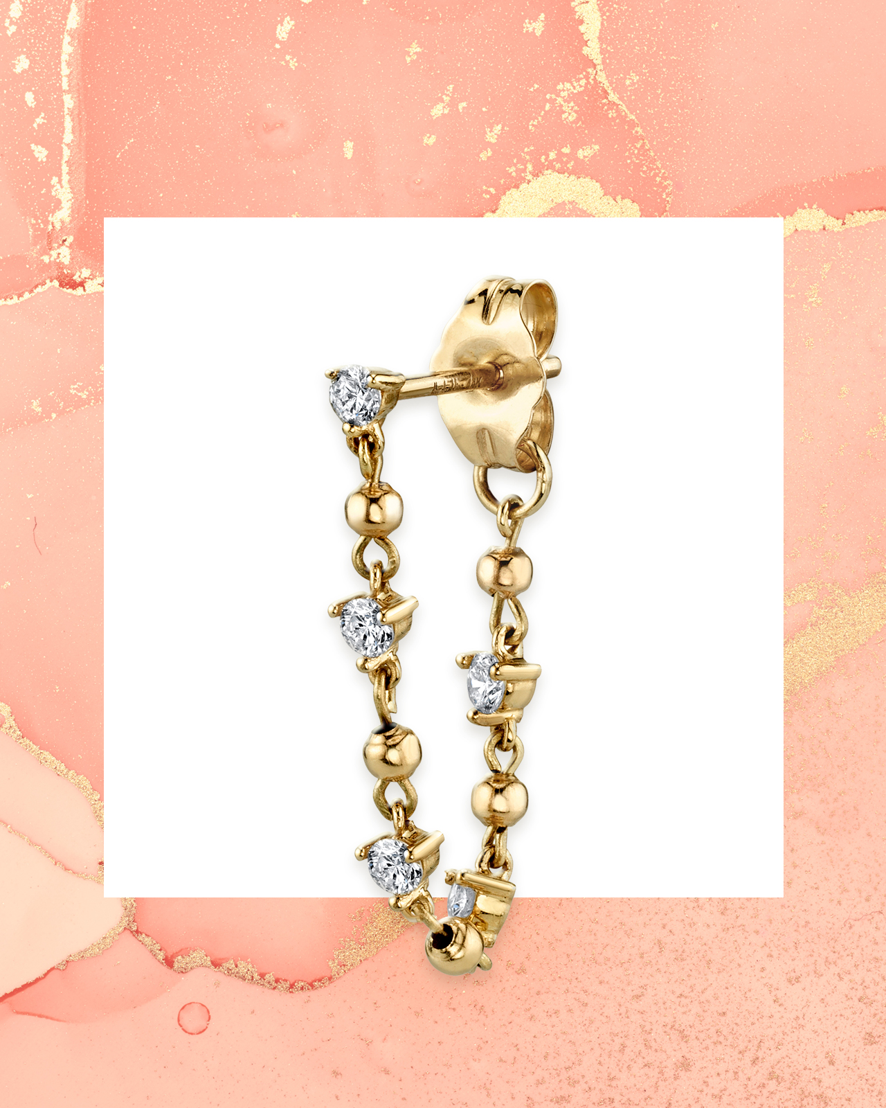 Round cut diamonds set within a yellow gold statement earring from Last Line