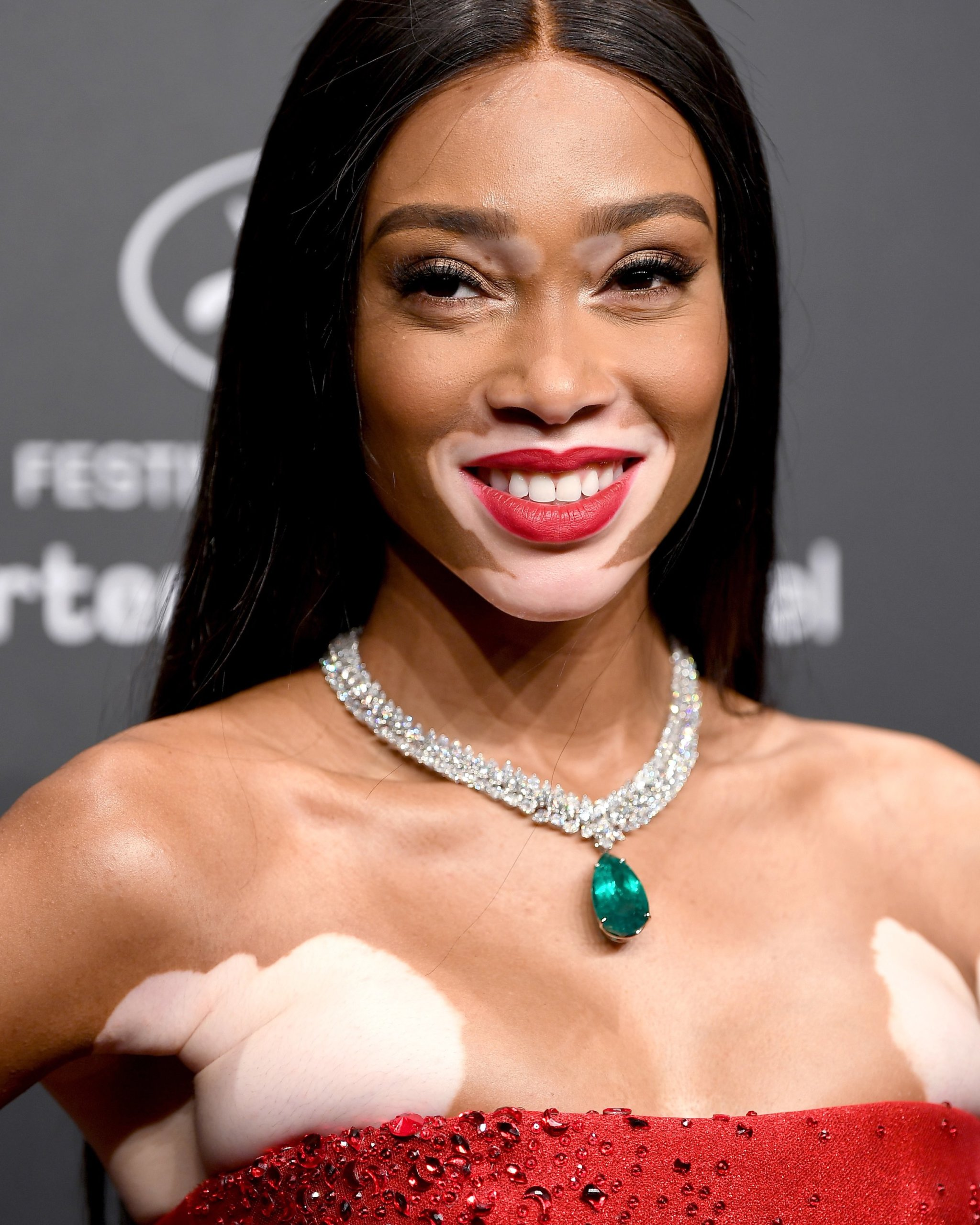 Pear shaped emerald & marquise diamond pendant necklace from Chopard worn by Winnie Harlow at 2017 Cannes Film Festival