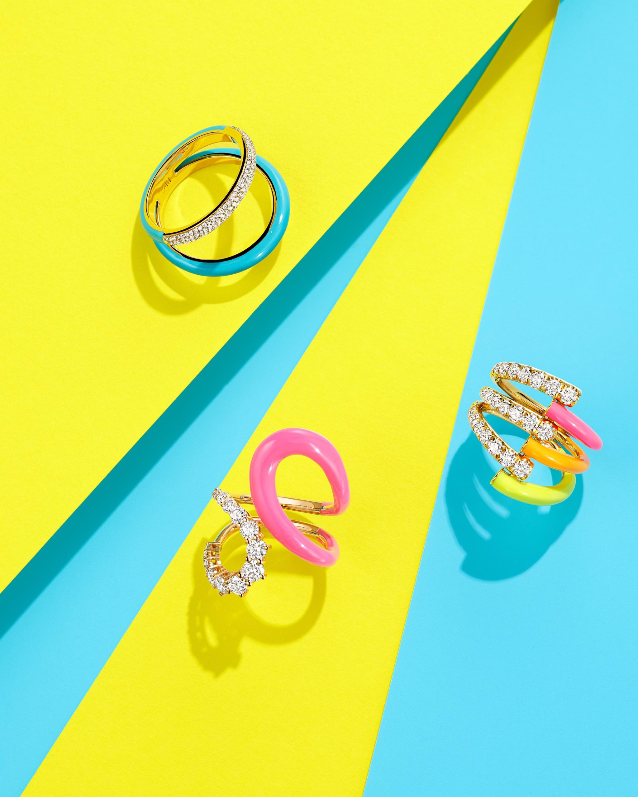 Bright blue enamel and diamond two band ring by EF Collection,  pink, orange & yellow enamel and diamond vine ring by Melissa Kaye, and abstract bright pink enamel & diamond band ring by Melissa Kaye