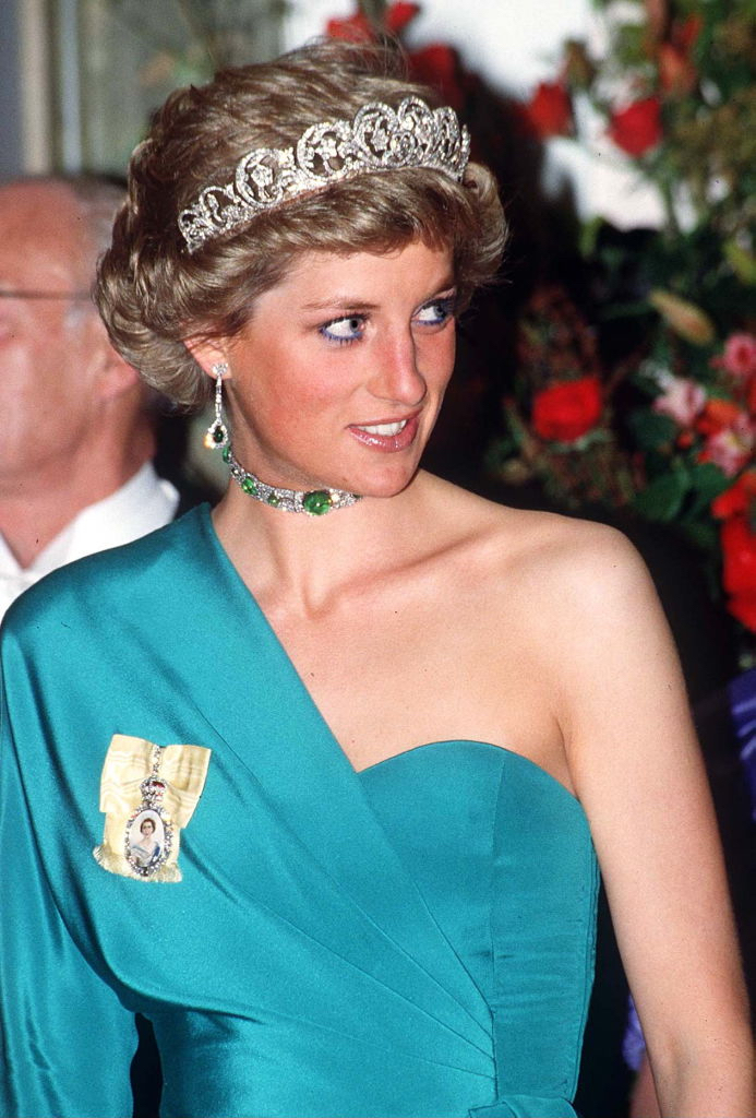 Princess Diana wearing the Spencer Tiara, diamond pendant earrings and a diamond choker with cabochon emeralds