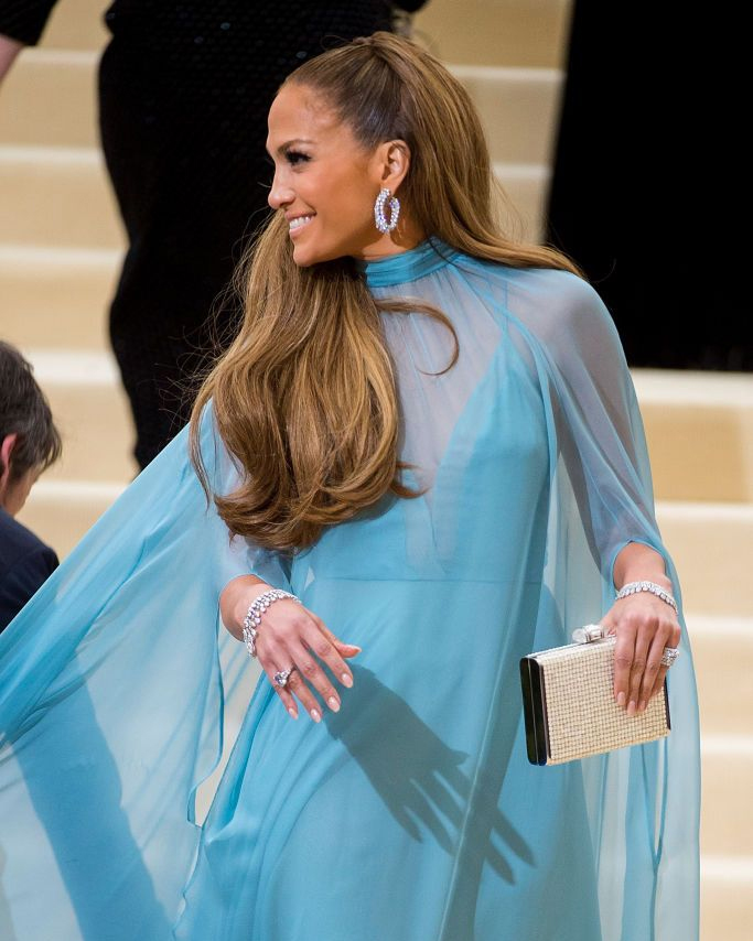 Jennifer Lopez hoop earrings look at the 2017 Met Gala featuring Harry Winston diamond hoop earrings and a turquoise blue Valentino gown