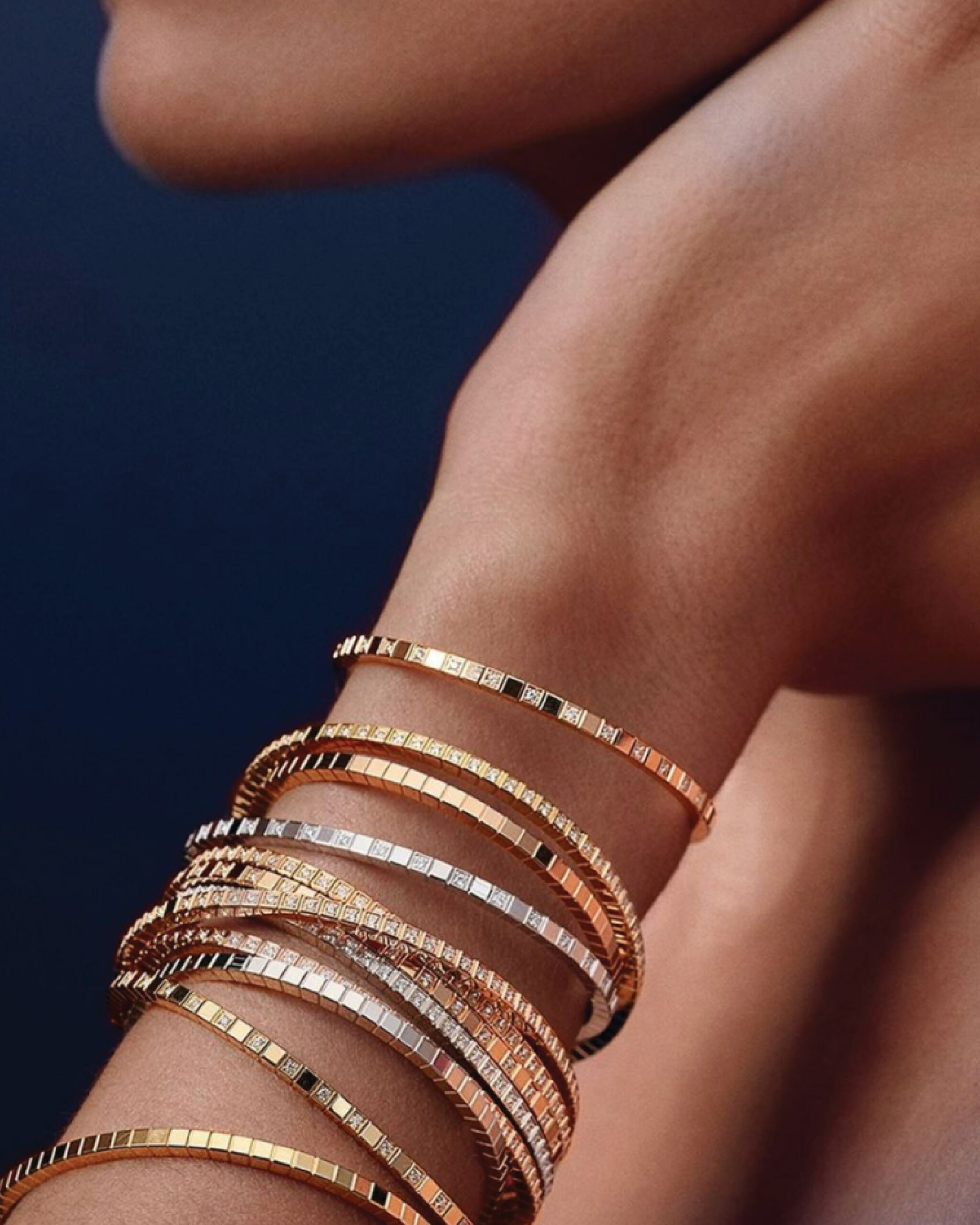 Ice Cube Pure Diamond Bangle bracelet from Chopard that features 18 karat yellow gold squares interspersed with diamonds