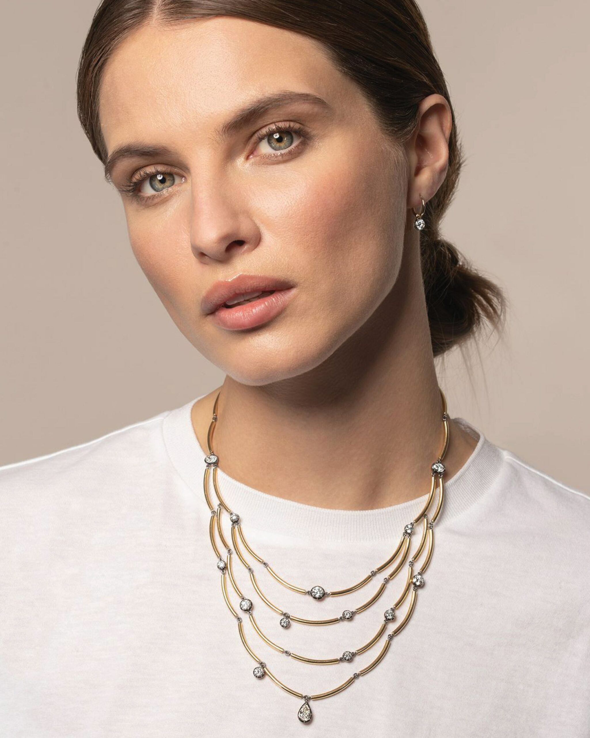 Chi Chi layered gold necklace from Jessica McCormack featuring several round cut diamonds across 4 strands