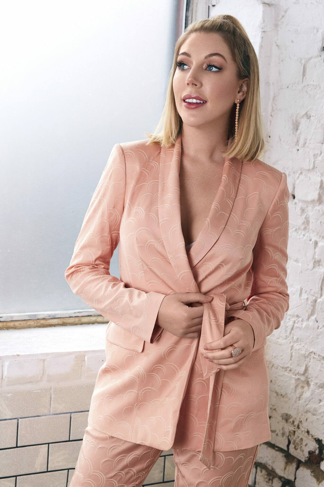 All that glitters host Katherine Ryan in pink tuxedo standing