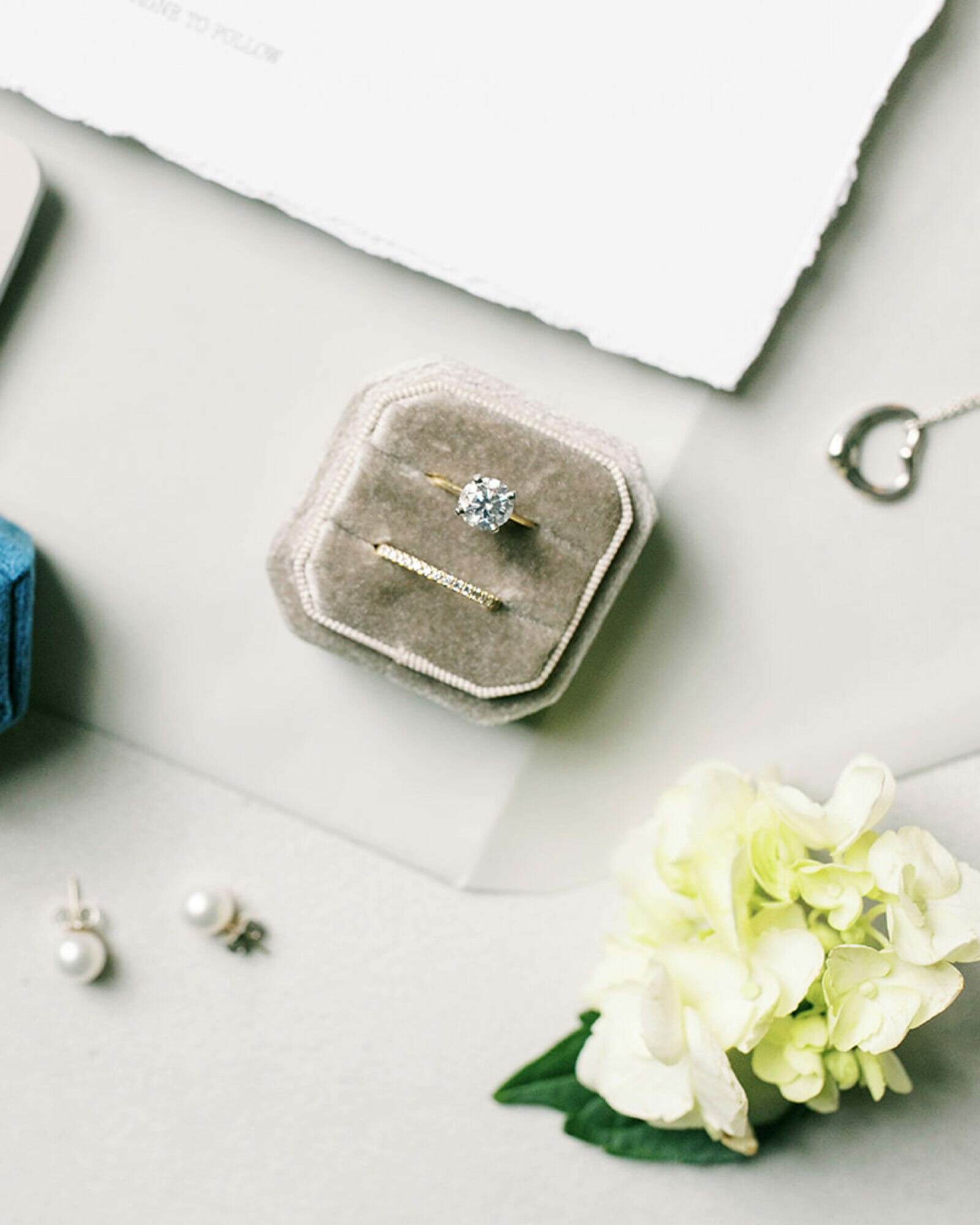 Camille's engagement ring and wedding ring