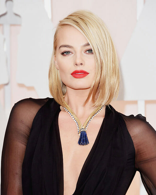 Margot Robbie wearing Van Cleef & Arpels's Zip necklace diamond jewelry to the 87th Annual Academy Awards.